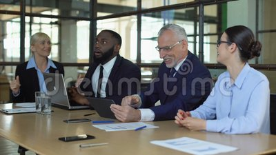 Excited business team celebrating work achievement checking sales results tablet. Stock footage stock video