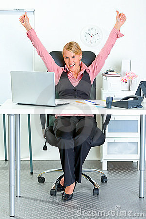 Excited business woman rejoicing her success