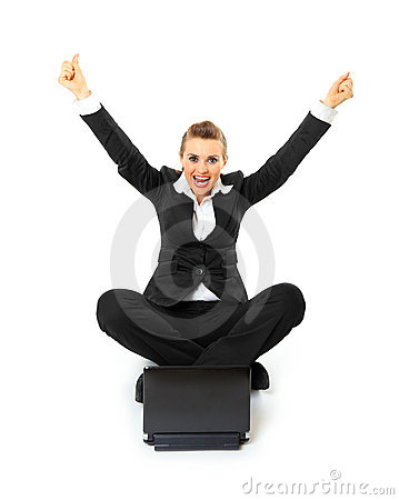 Excited business woman working on laptop