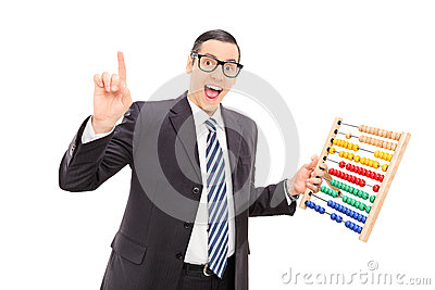 Excited businessman holding an abacus