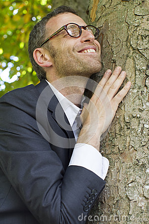 Free Excited Businessman Hugging A Tree For Vitality And Energy Royalty Free Stock Photo - 60378865