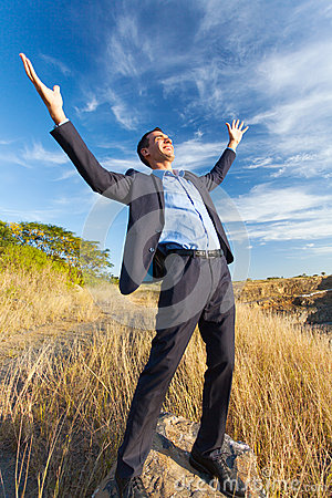 Excited businessman outdoors