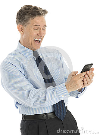 Excited Businessman Reading Text Message On Smart Phone