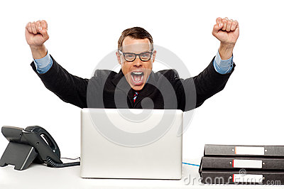 Excited businessman shouting and rejoicing