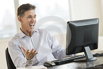 Excited Businessman Shouting White Using Desktop Pc
