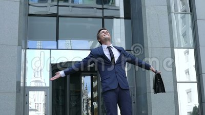Excited businessman showing winner gesture, celebrating company success, future. Stock footage stock video footage