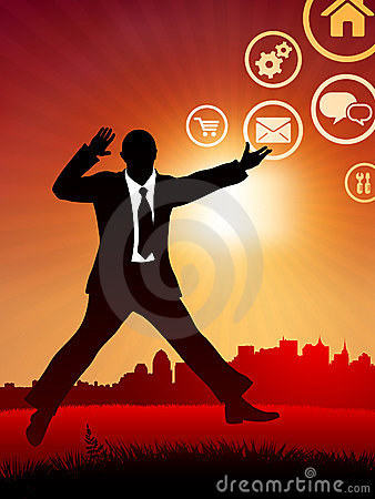 Excited businessman on sunset background