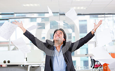 Excited businessman throwing papers