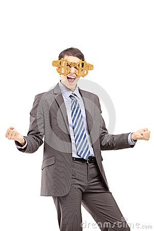 Excited businessman wearing dollar sign glasses and gesturing ha