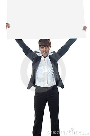 Excited businesswoman poisng with billboard