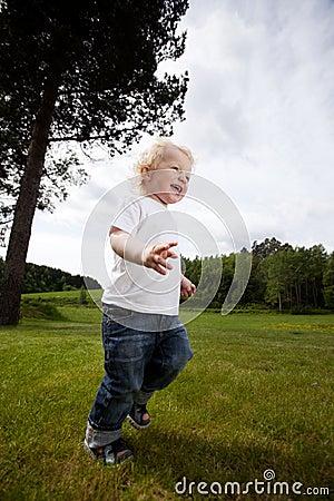 Excited Cheeful Boy Running