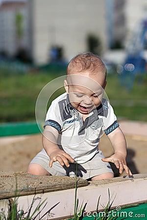 Excited child in sandbox