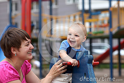 Excited child on wooden horse