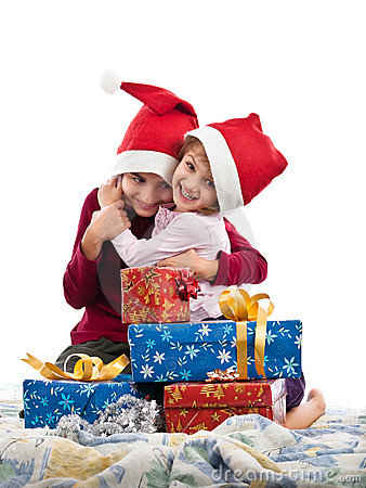 Excited children embraced near Christmas presents