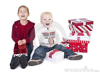 Excited Children opening their Christmas Gifts