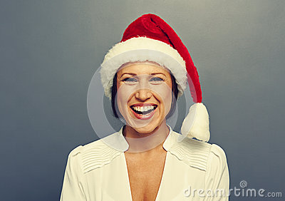 Excited christmas woman over grey
