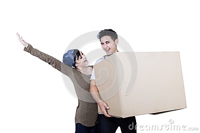 Excited couple bring box - isolated