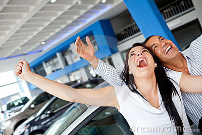 Excited couple buying a car