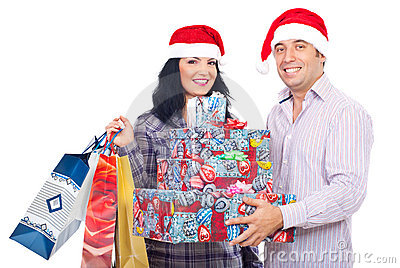 Excited couple holding Christmas presents
