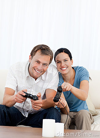 Excited couple playing video games together