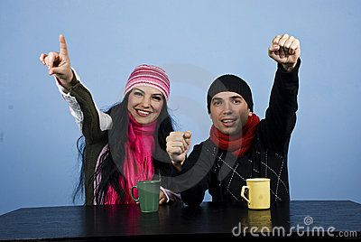 Excited couple at table in winter season