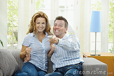 Excited couple watching TV