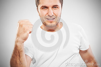 Excited energetic young man gesturing success