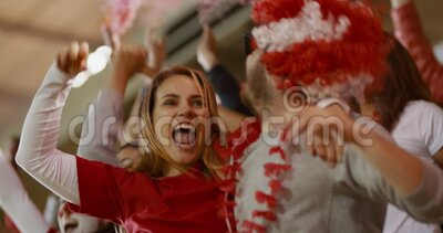 English soccer fans cheering in stands to support team. Excited England soccer supporters celebrating a victory. English soccer fans applauding in stands to stock video