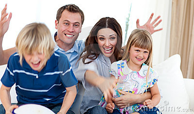 Excited family celebrating a goal