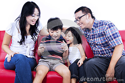 Excited family playing game on internet - isolated