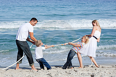 Excited family playing tug of war