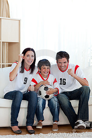 Excited family watching football match