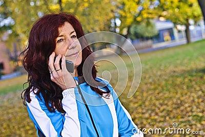 Excited female athlete using phone