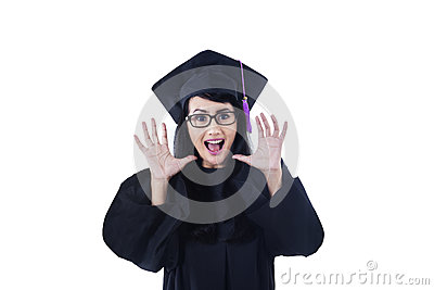 Excited female graduate screaming on white