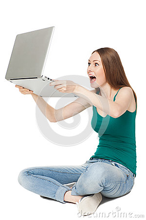 Excited female holding laptop