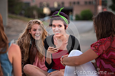 Excited Female Teens Looking at Phone