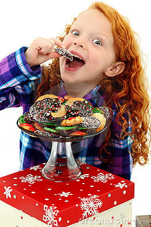 Excited Girl Child in Pajamas with Tray of Cookies