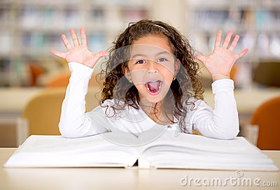 Excited girl reading a book