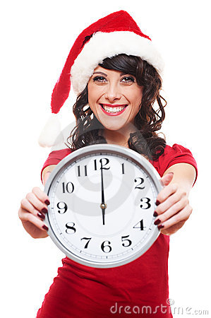 Excited girl with santa hat holding clock