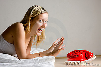 Excited girl by telephone