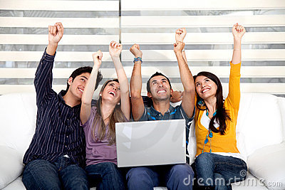 Excited group with laptop