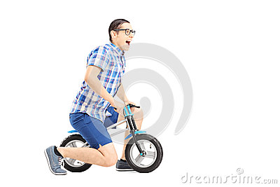 Excited guy riding a small bicycle