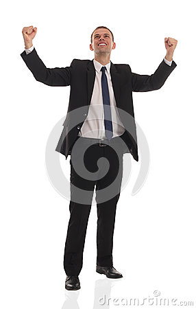 Excited handsome business man with arms raised in