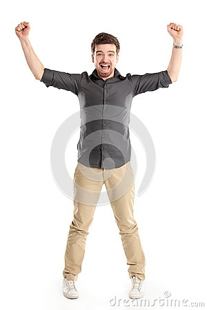 Excited handsome man with arms raised in success