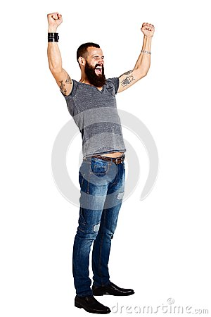Free Excited Handsome Tattooed Bearded Man With Arms Raised Stock Image - 48602061