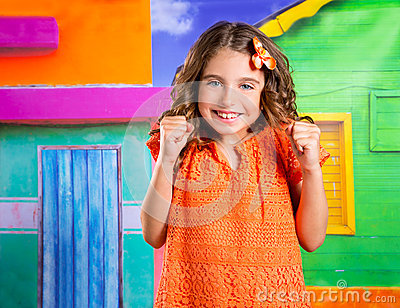 Excited happy expression children girl in a tropical house vacat
