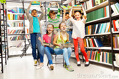 Excited happy laughing children in library