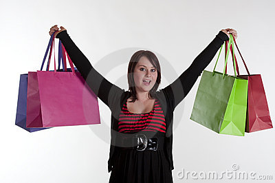 Excited happy teenage girl after shopping spree