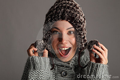 Excited happy young girl in warm winter wool hat