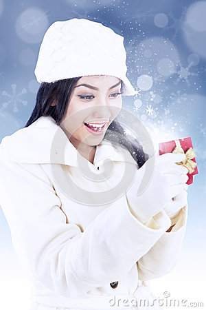 Excited lady open christmas gift box on blue light